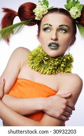 Beautiful young woman with exotic flower hair style.