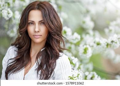 Beautiful young woman face closeup - perfect skin
