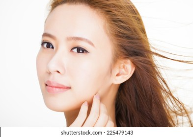 beautiful young woman face with hair motion . skin care and hair salon concept.