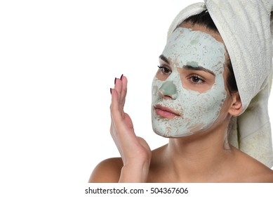 Beautiful young woman with face mask isolated on white background