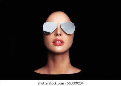 beautiful young woman face in sunglasses.fashion beauty make-up girl in glasses isolated on black