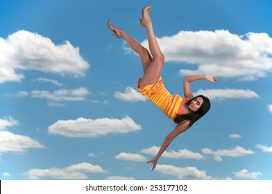 Beautiful young woman falling through the sky