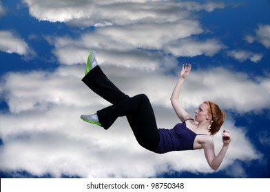 A beautiful young woman falling through the sky