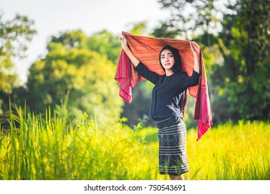 Beautiful young woman farmer in Thailand,Woman smiling with perfect smile and happy in forest.