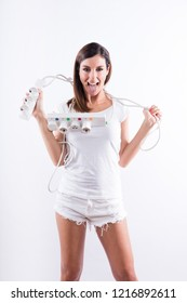 A beautiful young woman feeling happy with power cables in her hands