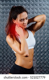 Beautiful young woman feeling pain in her neck during sport workout indoors, close-up. Grey metal surface with a bumpy pattern background. Digital composite.