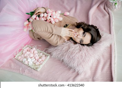 Beautiful young woman flowers bouquet pink stock photo edit now beautiful young woman with flowers bouquet in pink dress lying on floor indoor portrait mightylinksfo