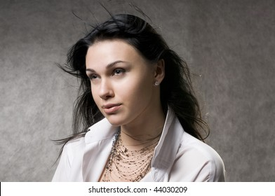 Beautiful young woman with fluttering long hair.