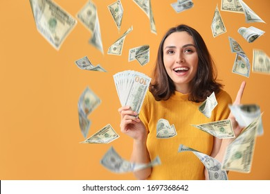 Beautiful young woman with flying money on color background