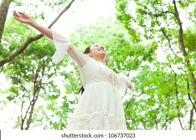 Beautiful young woman in the forest. Portrait of asian.