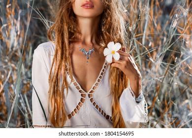 beautiful young woman with frangipani close up portrait