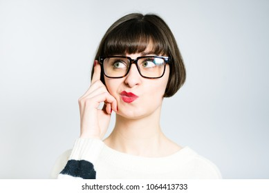 beautiful young woman is funny nervous, short haircut, studio photo on background