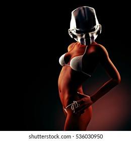 Beautiful young woman with futuristic helmet and bikini