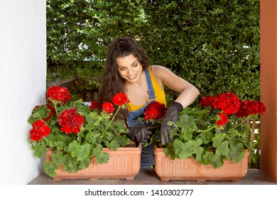 Beautiful young woman gardening with garden tools, spring concept