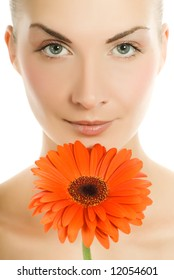 Beautiful young woman with gerbera flower isolated on white background