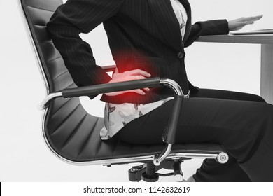 Beautiful young woman gesture to touching back pain or lower back pain with Red highlights or suffering from backache in office. female Back ache and feeling her back tired working. office syndrome