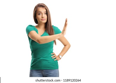 Beautiful young woman gesturing stop with her hand isolated on white background