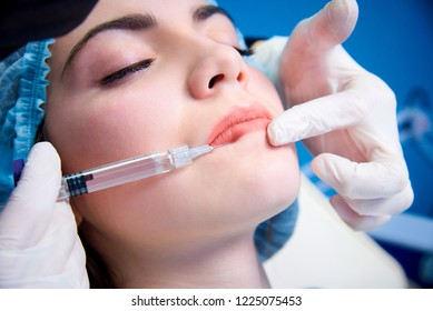 Beautiful young woman gets injection in lips.Beauty injections and cosmetology.Plastic and aesthetic surgery.