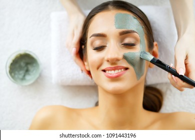 Beautiful Young Woman Getting a Face Treatment at Beauty Salon.Skin and care. Beautiful Woman Lying With Face Mask. Pure and Beautiful Skin.