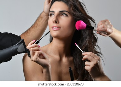 Beautiful young woman getting her hair and make up done, beauty concept, studio shot