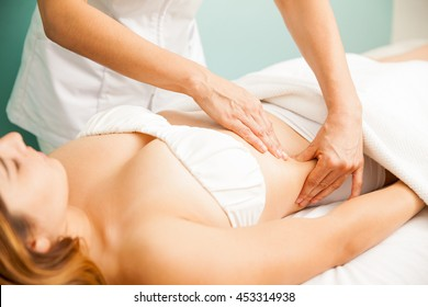 Beautiful young woman getting a lymphatic massage at a health and beauty spa