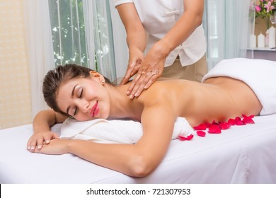 A beautiful young woman getting a massage or spa to keep healthy and happy.