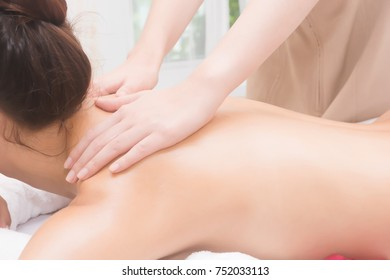beautiful young woman getting a massage, refreshing, healthy and happy on a white bed.