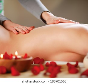 Beautiful young woman getting spa massage