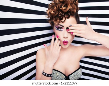 Beautiful young woman glam rock style fashion and make up