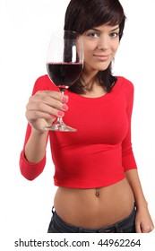Beautiful young woman with glass of wine in front of white background