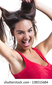 Beautiful young woman grabbing her own hair, isolated over white backgrund