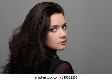 Beautiful young woman in gray background