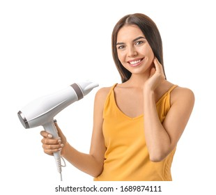 Beautiful young woman with hair dryer on white background