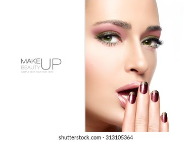 Beautiful young woman with hands on her face covering her mouth. Perfect skin. Nail art and makeup concept. Autumn winter trendy make-up. High fashion Portrait isolated on white with sample text
