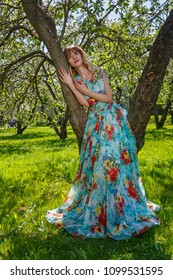 Beautiful young woman happy in spring, blooming garden