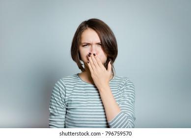 beautiful young woman has nausea, isolated on background, studio photo