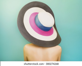 Beautiful young Woman in Hat drink soda. Fashion portrait. Elegance Beauty Girl with blue hair. colorful hat