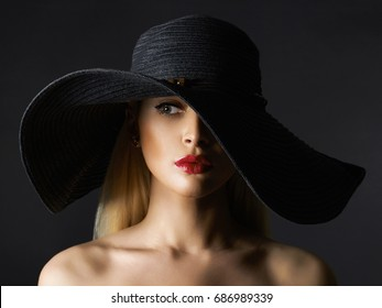048ce627e Beautiful young woman in hat. fashion beauty blonde girl with make-up