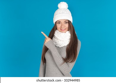 Beautiful young woman with hat and scarf - winter portrait