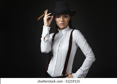 beautiful young woman in hat smoking cigarette