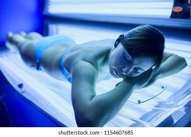 Beautiful Young Woman Have Tanning Skin Treatment In Modern Solarium