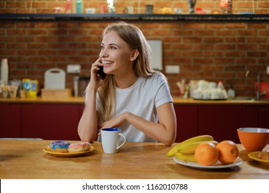 Beautiful young woman having breakfast