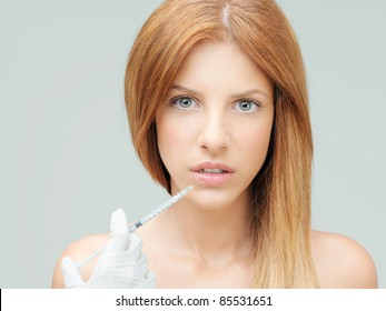 beautiful young woman having colagen injection lips