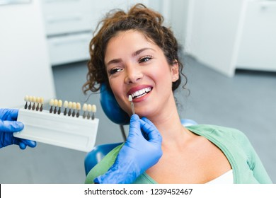 Beautiful young woman having dental treatment at dentist's office.