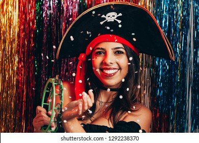 Beautiful young woman having fun with a fake party pirate costume. Brazilian Carnival concept
