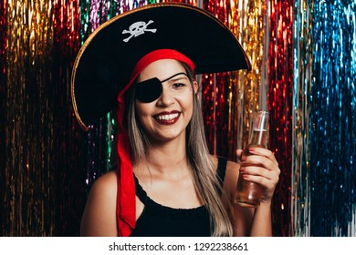 Beautiful young woman having fun with a fake party pirate costume