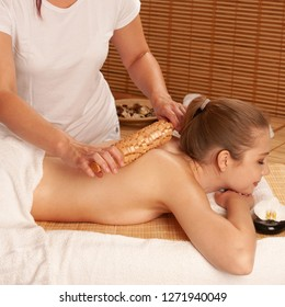 Beautiful young woman having a maderotherapy massage  treatment in spa salon - wellness