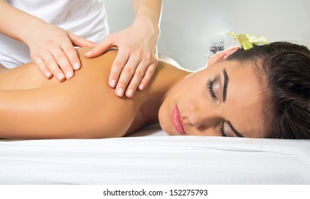 Beautiful young woman having a massage in a beauty salon