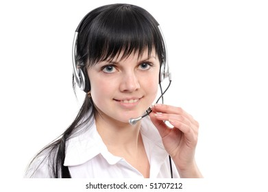 Beautiful young woman in headphones smiles in current of telephone conversation on a white background