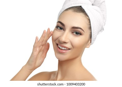 Beautiful young woman with healthy skin softened by cream with moisturizing effect, on white background